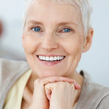 Smiling older woman with dentures