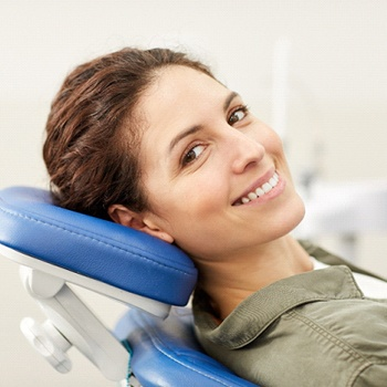 smiling woman reclining in dental chair