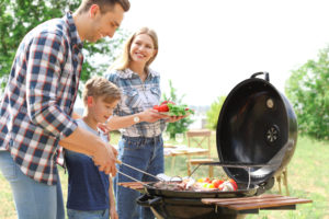 Family of three grilling out